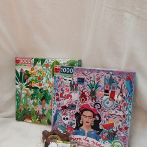 a photo of both 1000 piece puzzles and 2 chocolates